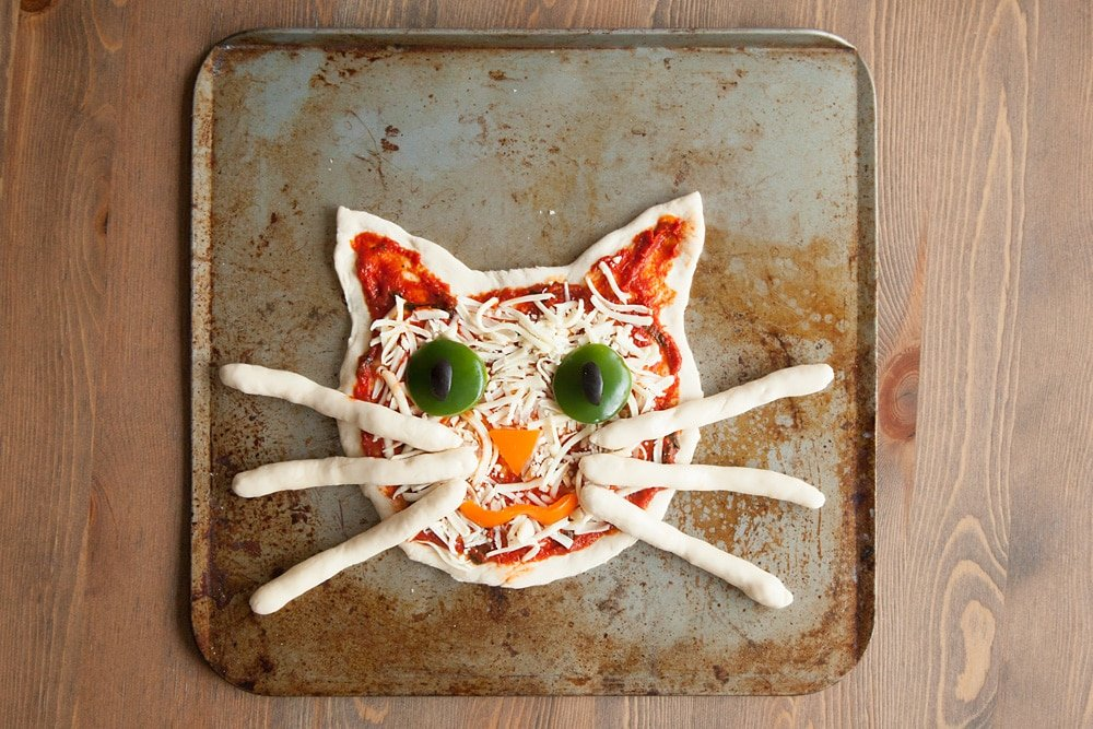 The assembled kitty pizza, ready to be cooked in the oven