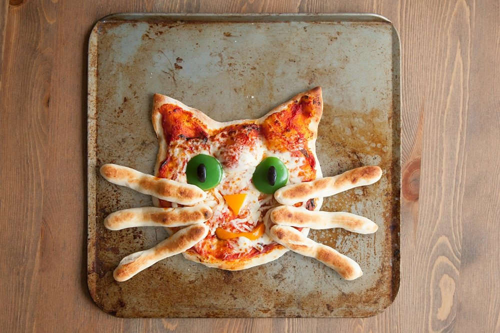 Freshly baked kitty pizza with breadstick whiskers