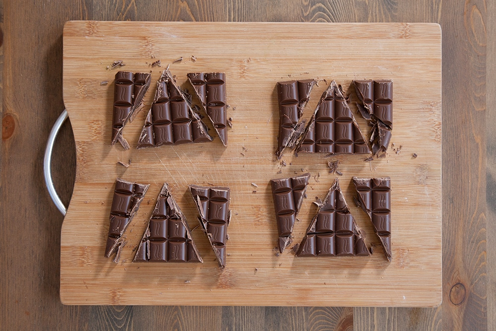 Cutting chocolate bars into triangles to create the pastry fillings