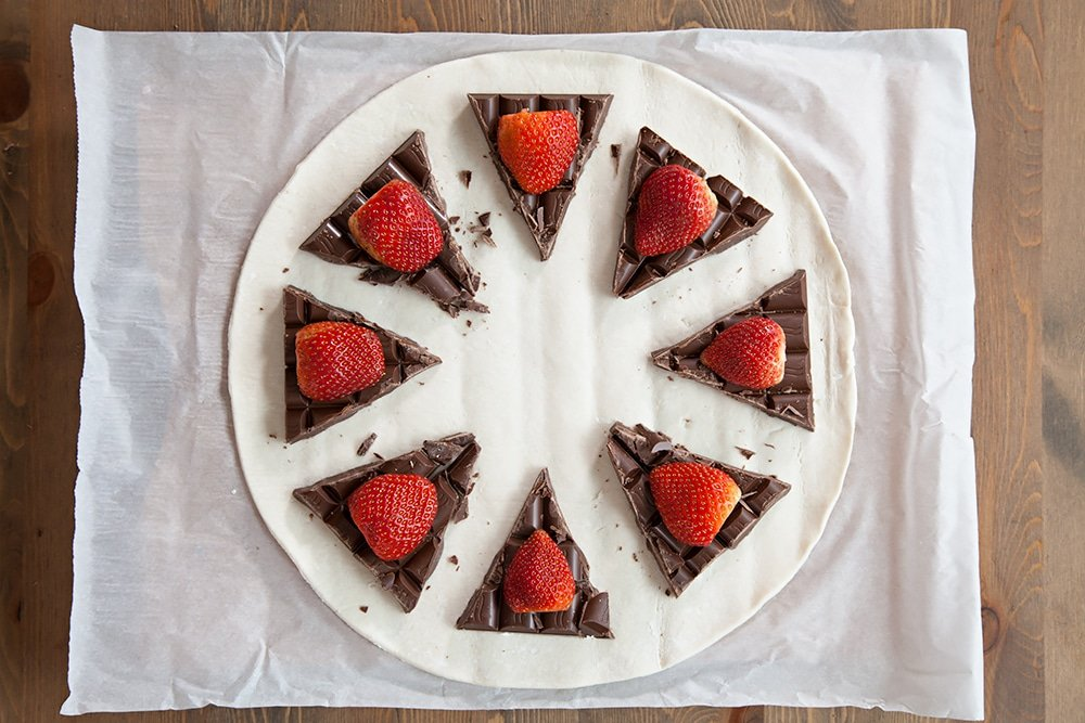 Top the chocolate with a strawberry to complete the filling