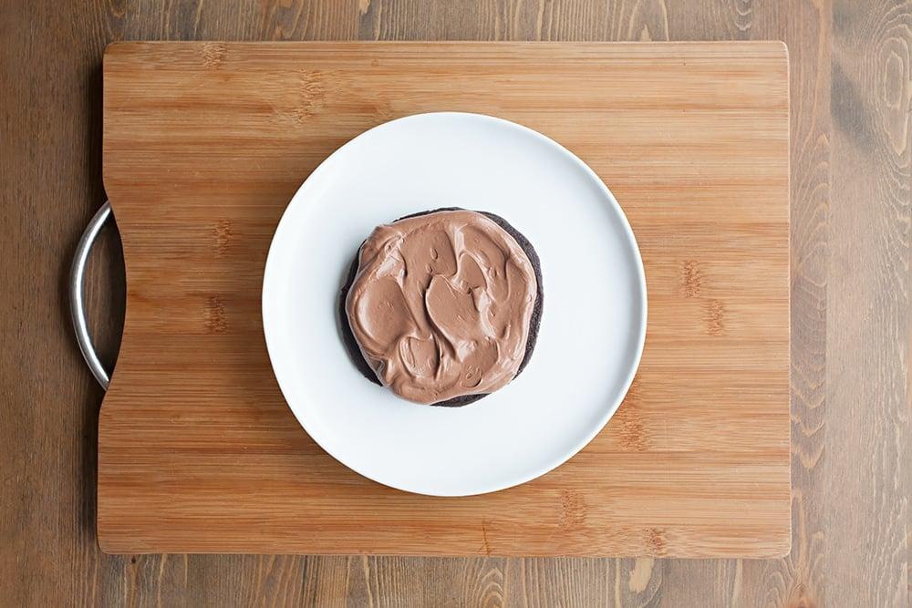Add a layer of chocolate fudge icing