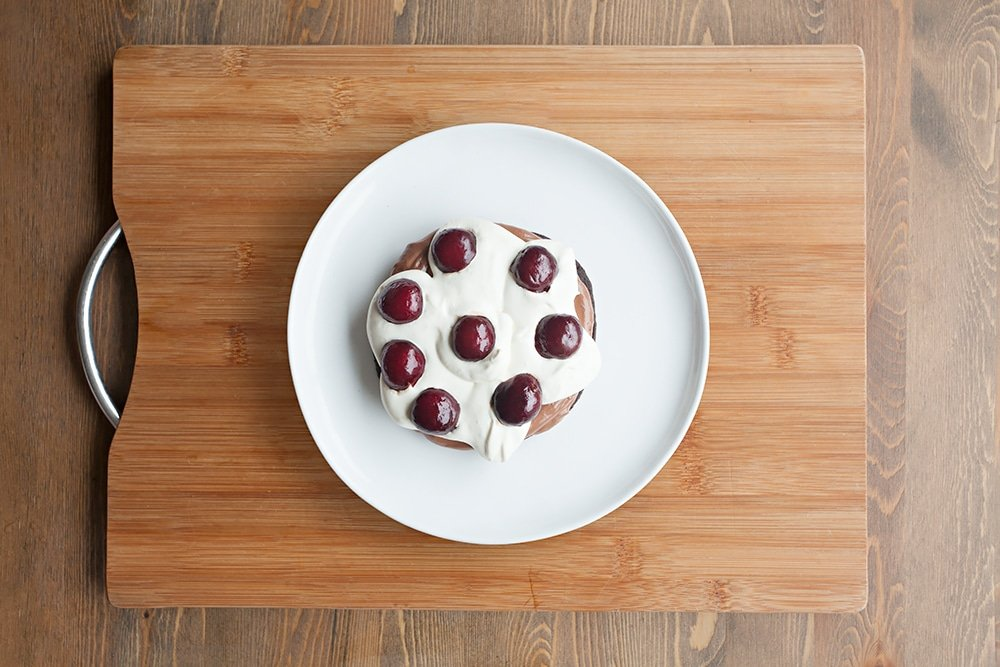 Add a layer of pitted, halved cherries to the black forest pancake stack