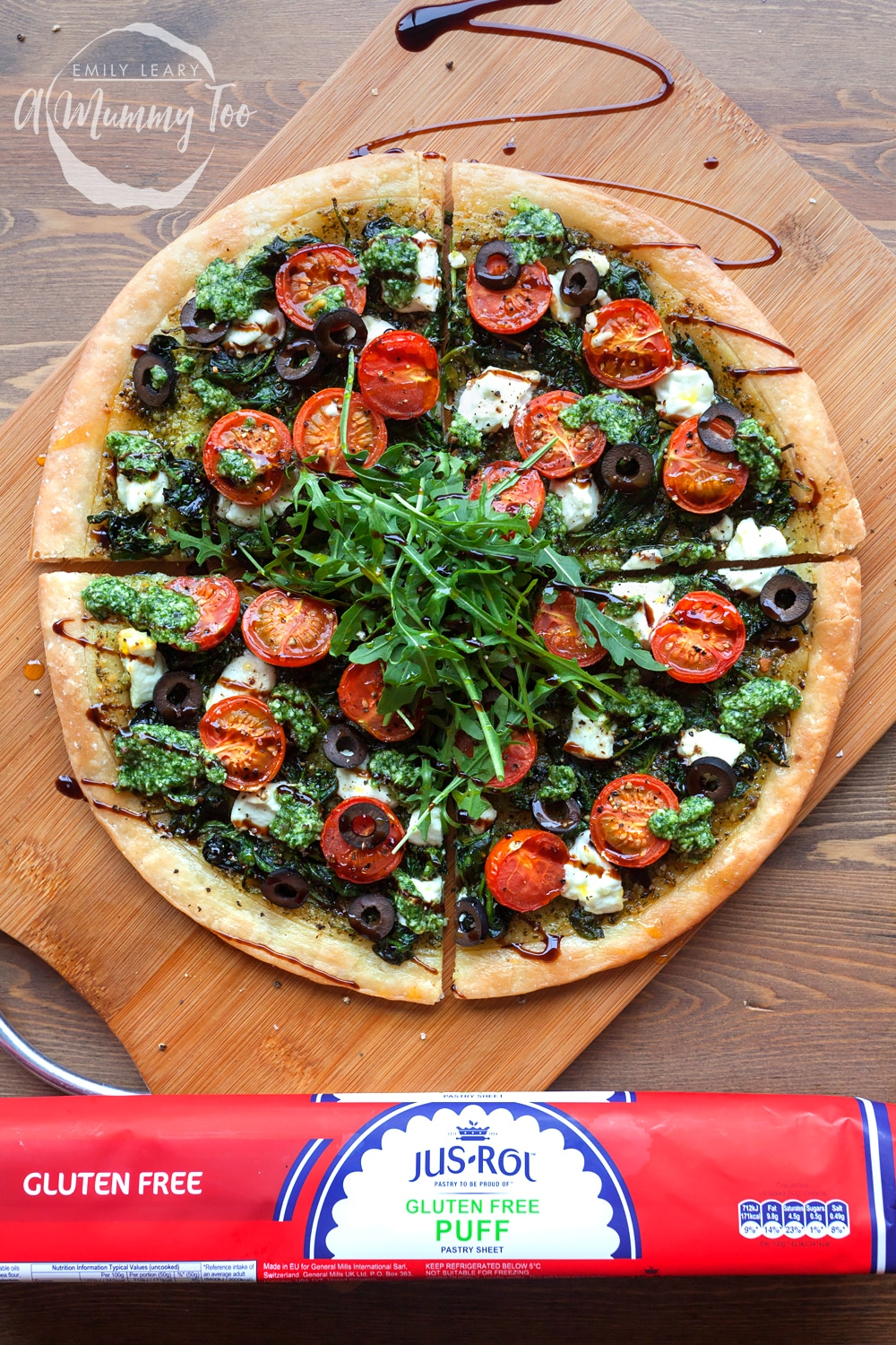Serve your gluten-free spinach and goat's cheese pesto tart with sliced olives, rocket and a drizzle of balsamic glaze