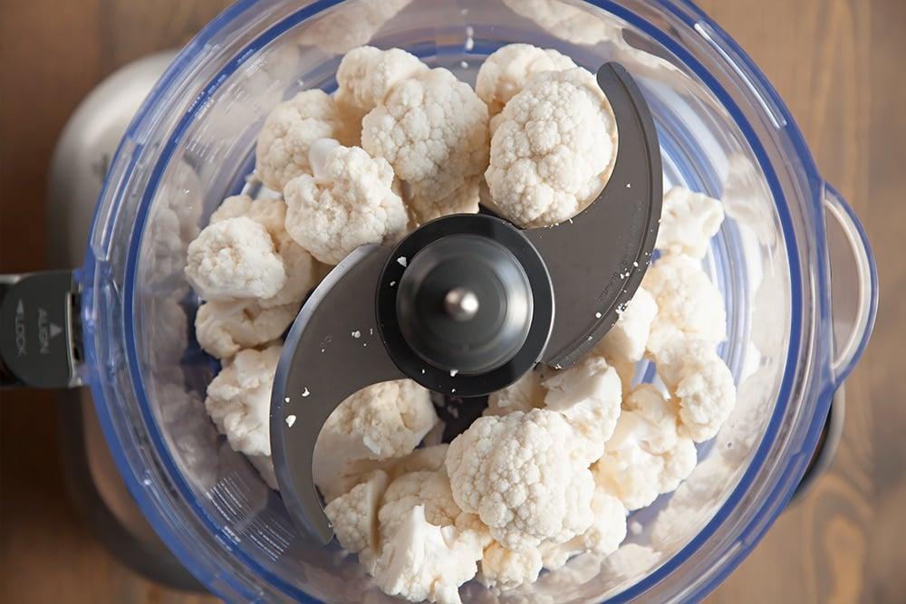 Preparing the cauliflower for the crust in a food processor