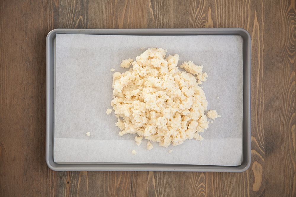 Preparing the cauliflower crust base for baking