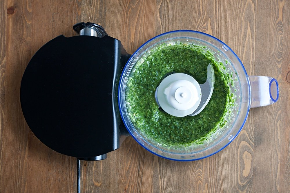 Blitzing the ingredients together to make pesto
