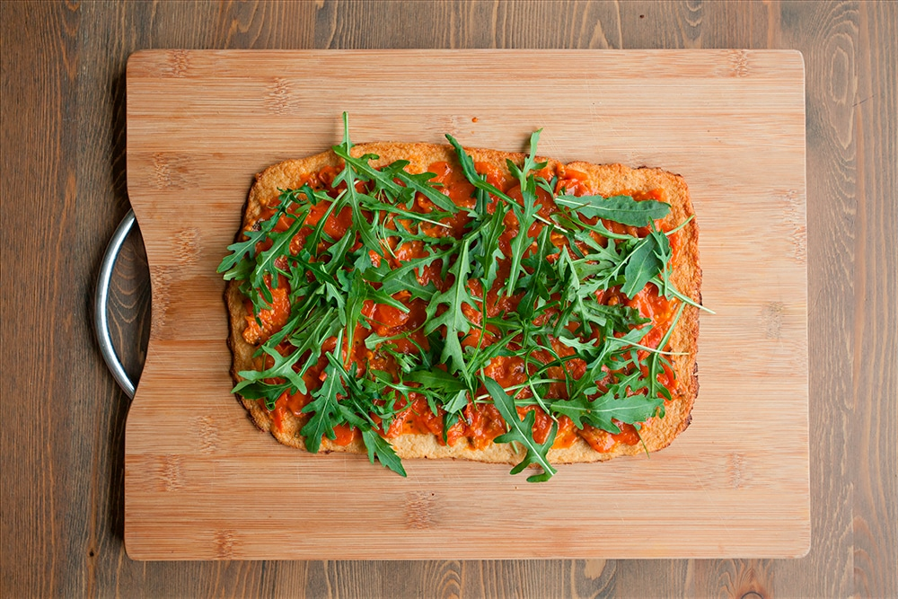 The Grana Padano and Prosciutto di San Daniele cauliflower crust pizza is sprinkled with rocket
