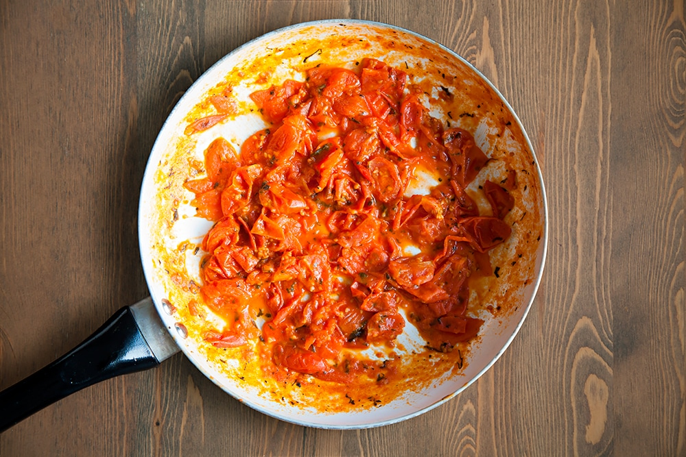 Cooking the tomatoes for the Grana Padano and Prosciutto di San Daniele cauliflower crust pizza sauce