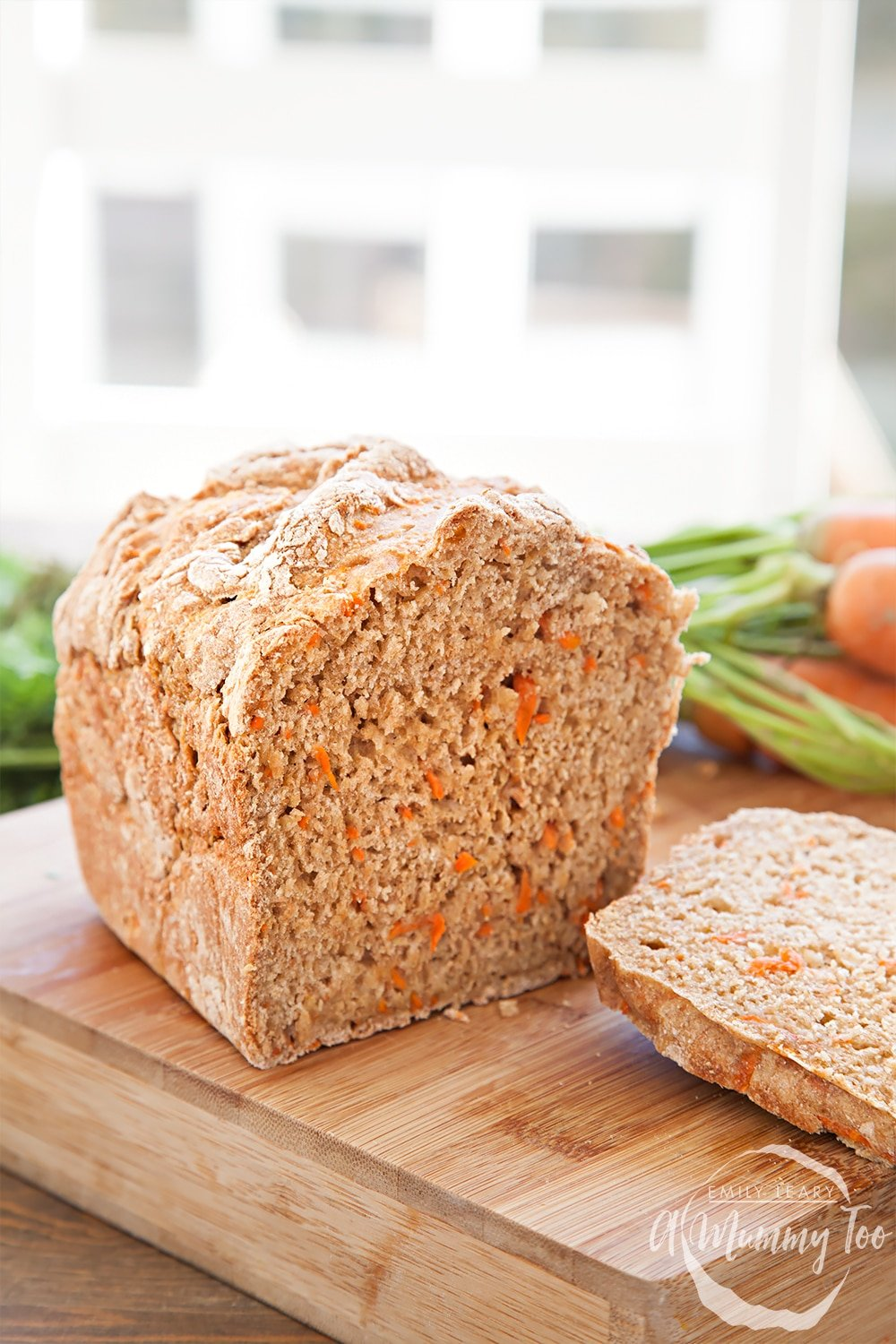 Slice the freshly baked carrot soda bread, ready to assemble the home-grown carrot soda bread egg and cress sandwiches