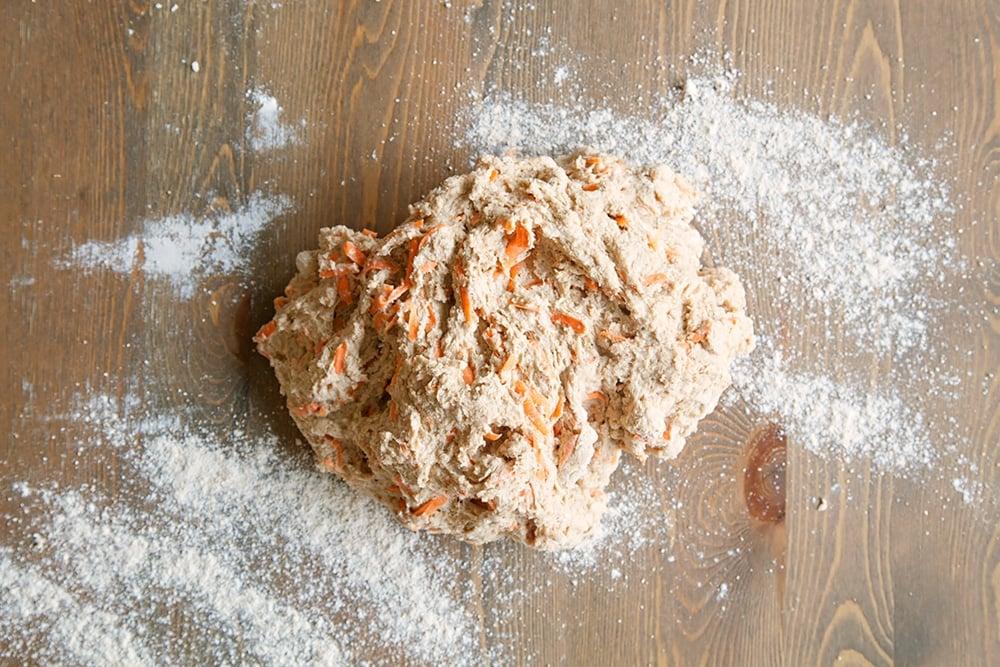 Preparing the carrot soda bread dough for baking