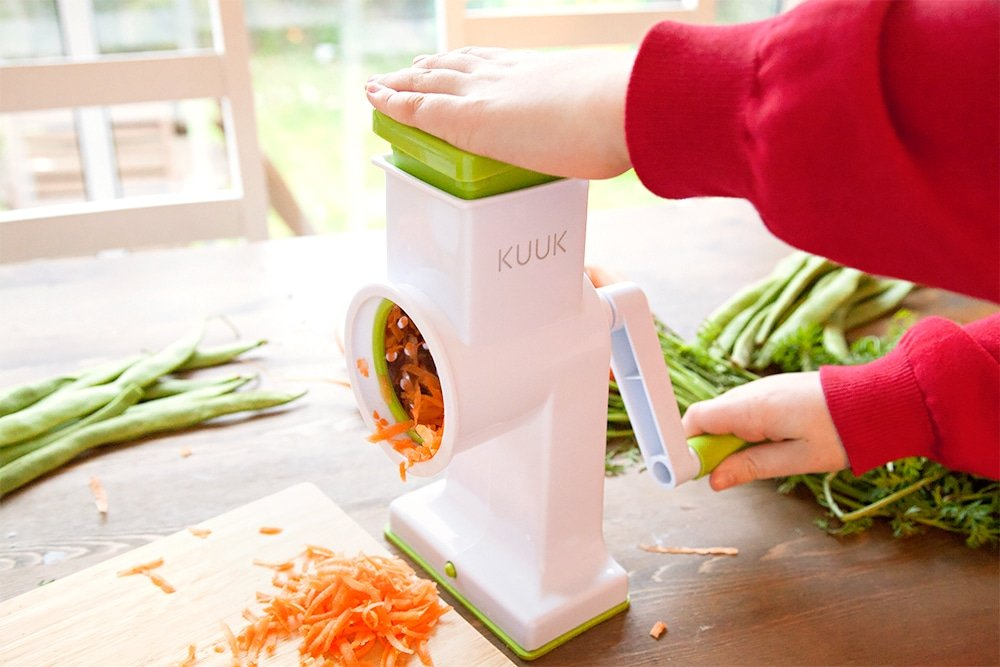 You could use a rotary grating tool to let kids get involved with grating the carrots