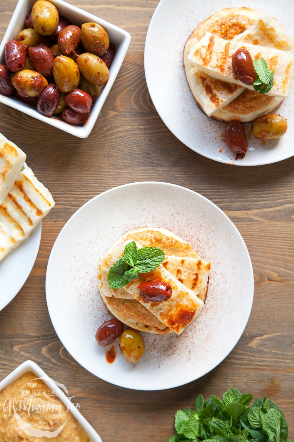 Finish your gluten-free meze-inspired crumpets with a topping of harissa olives and mint leaves!