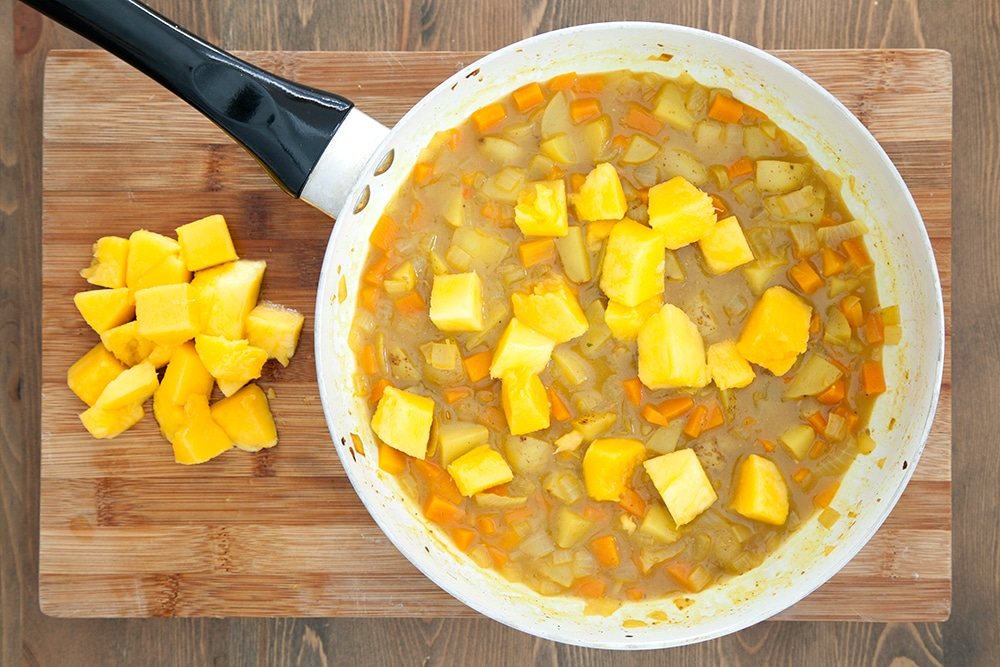 Mango is added to the vegetable curry, adding a sweet flavour and aroma