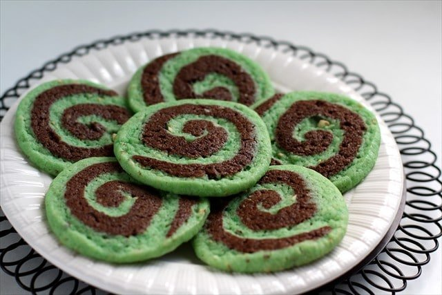 Chocolate Pistachio Pinwheel Cookies by butter with a side of bread