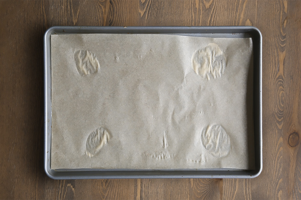 Line the baking tray with greaseproof paper