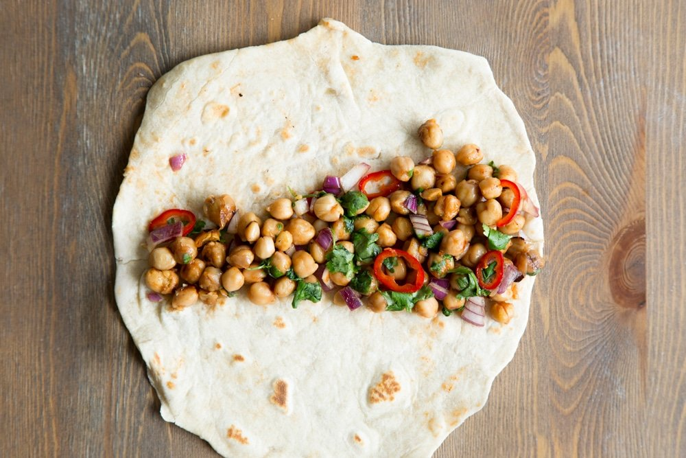 Assemble your summer BBQ chickpea wraps by adding 1/8 of the mixture to your tortilla wrap