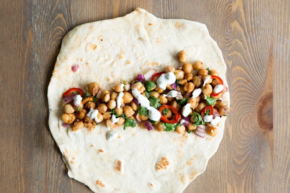 Drizzle some of your dressing onto the tortilla wrap