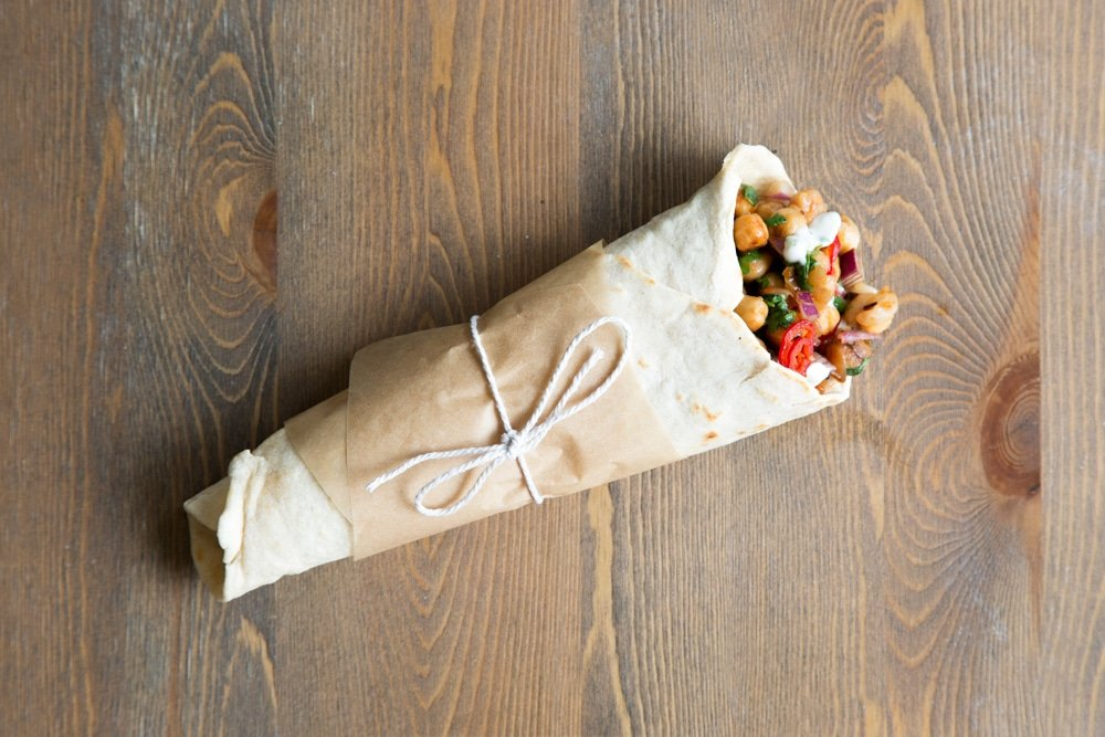 Finish your summer BBQ chickpea wraps by wrapping in greaseproof parchment, tie with string and serve to your BBQ guests