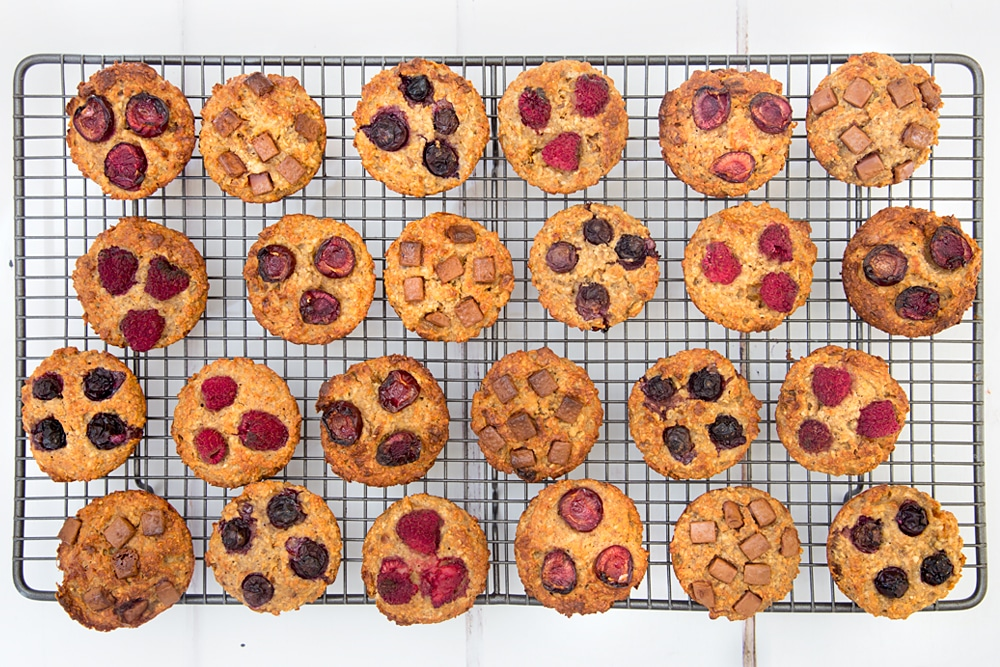 Yummy yogurty summer fruits breakfast muffins cooling on a wire rack. Soon they'll be ready to enjoy at breakfast, or packed away for a school lunch or picnic