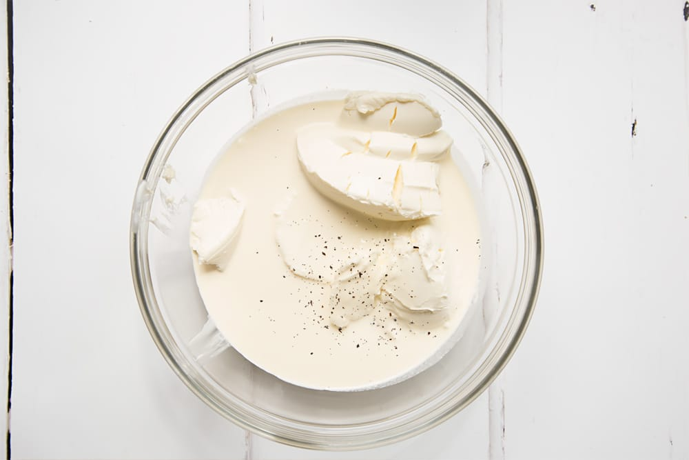 Cream cheese, cream and vanilla are mixed together
