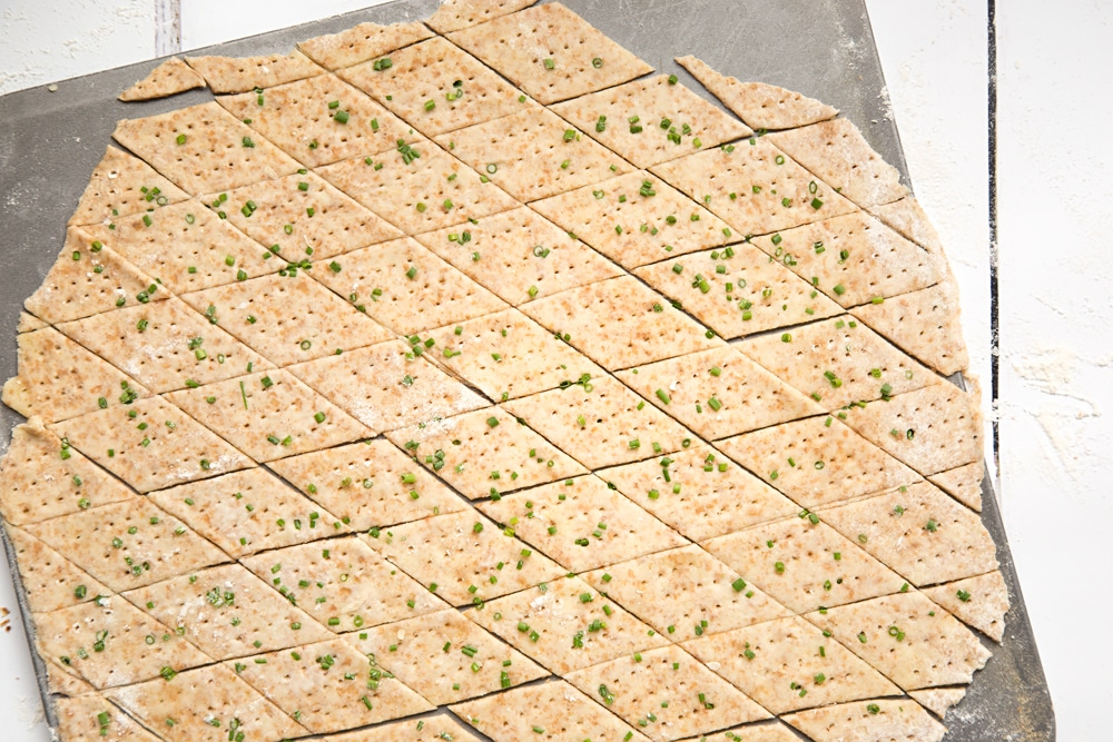 Preparing the gruyère and chive crackers to be baked