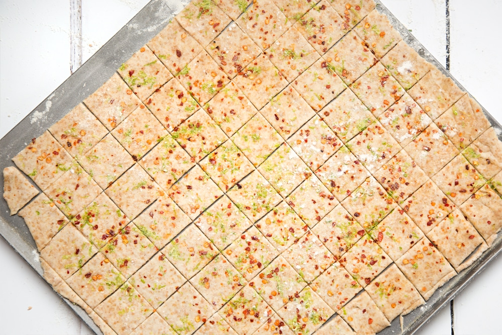 Slicing the lime and chilli cracker dough into crackers