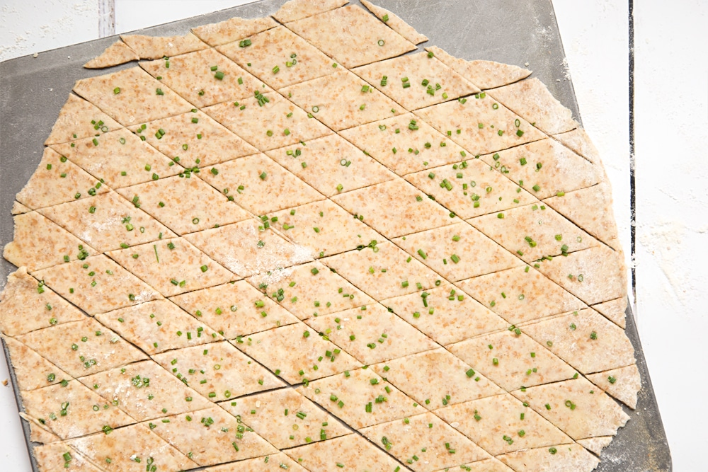 Gruyère and chive crackers on a baking tray, ready to be baked