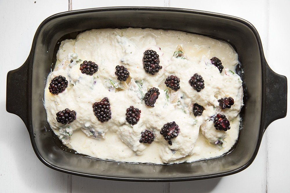 The ricotta blackberry stuffed giant pasta shells is topped with blackberries