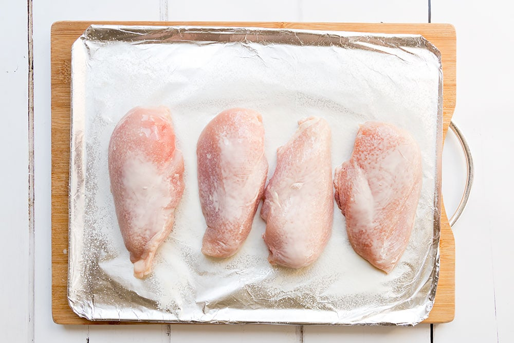 Preparing the chicken breasts for roasting