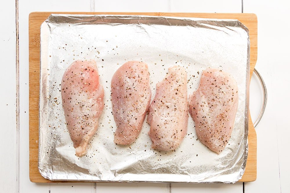 Seasoning the chicken breasts ahead of cooking