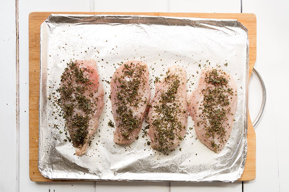 The herb topped chicken and parsnip fries are ready to cook in the oven