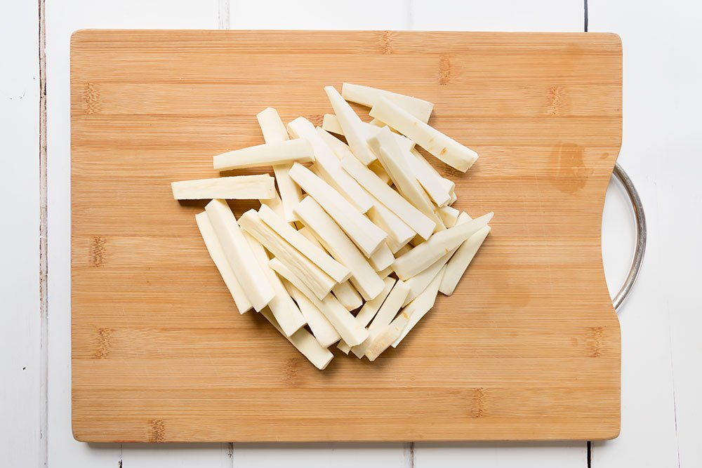 Sliced parsnips become fries to accompany the herby baked chicken