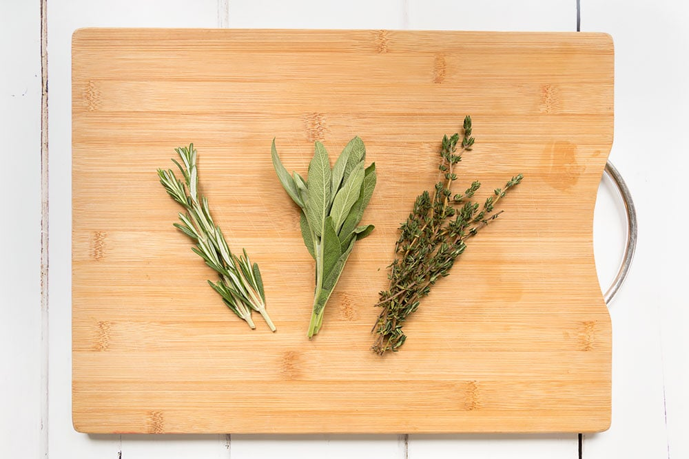 Rosemary, thyme and sage help flavour the chicken