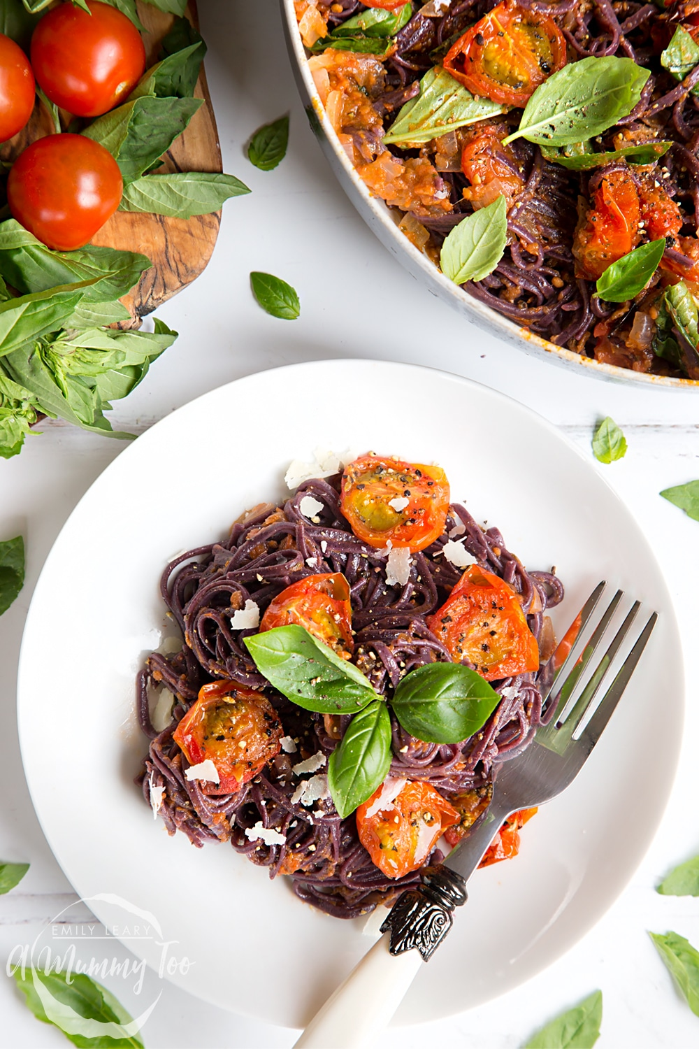 Top the black spaghetti with roasted tomatoes with shavings of vegan cheese, serve and enjoy!