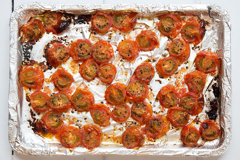Baking cherry tomatoes to add to the black spaghetti and tomato sauce