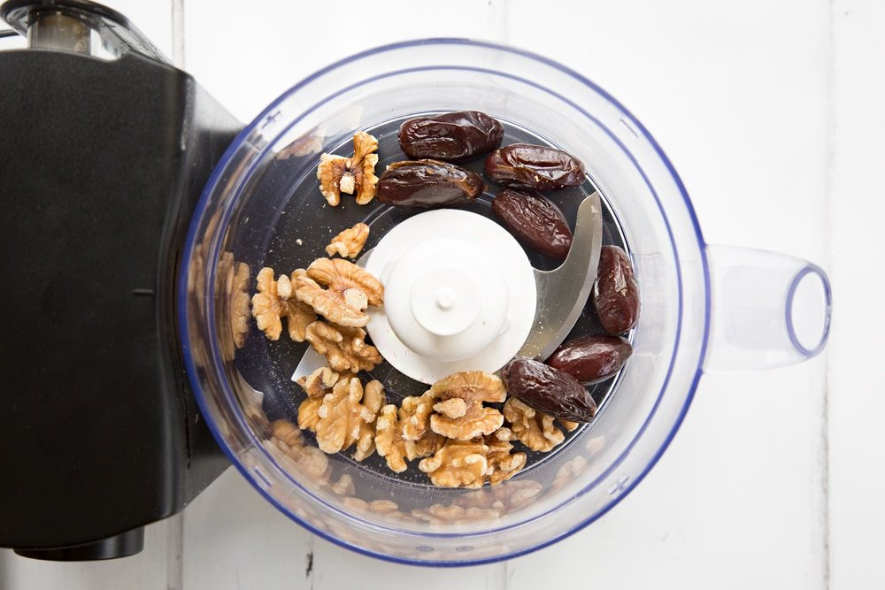 Blitzing dates and walnuts in a food processor