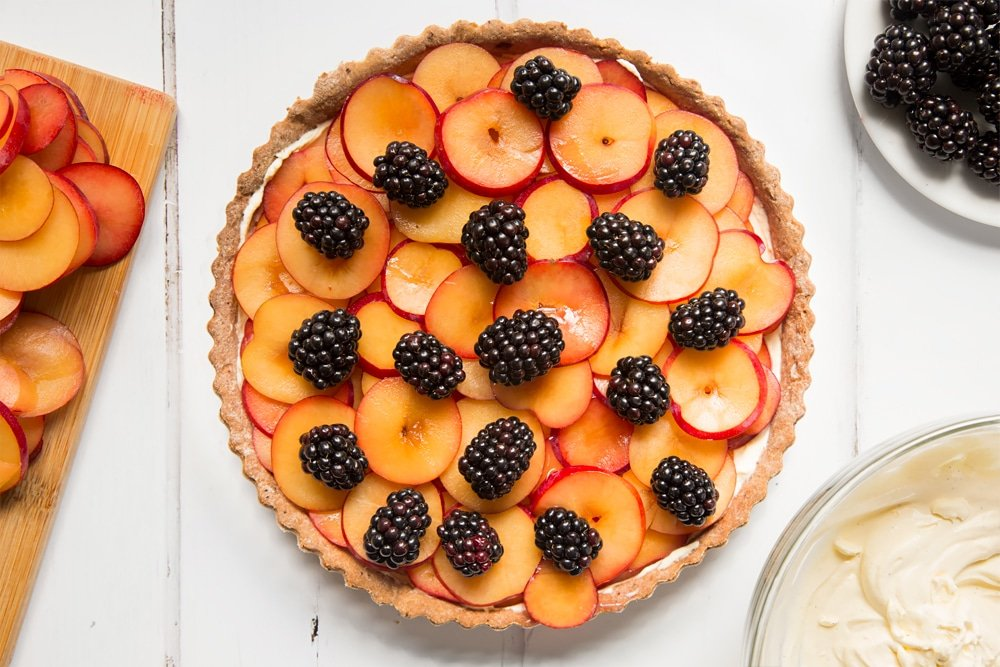The tart is then topped with blackberries