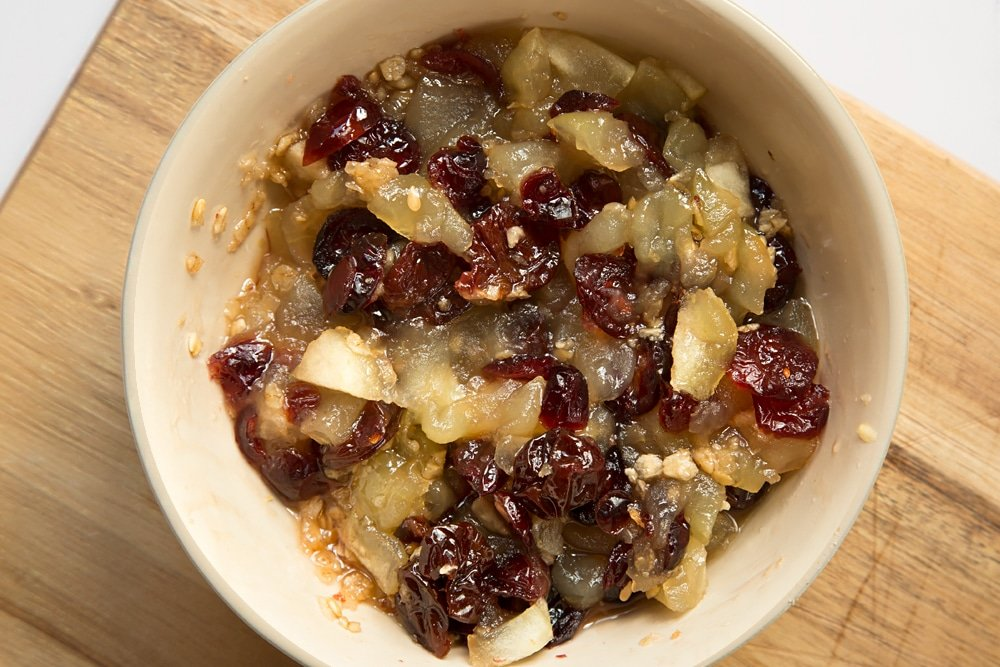 The fruits are softened in a microwave to make the filling for this apple cherry granola crumble
