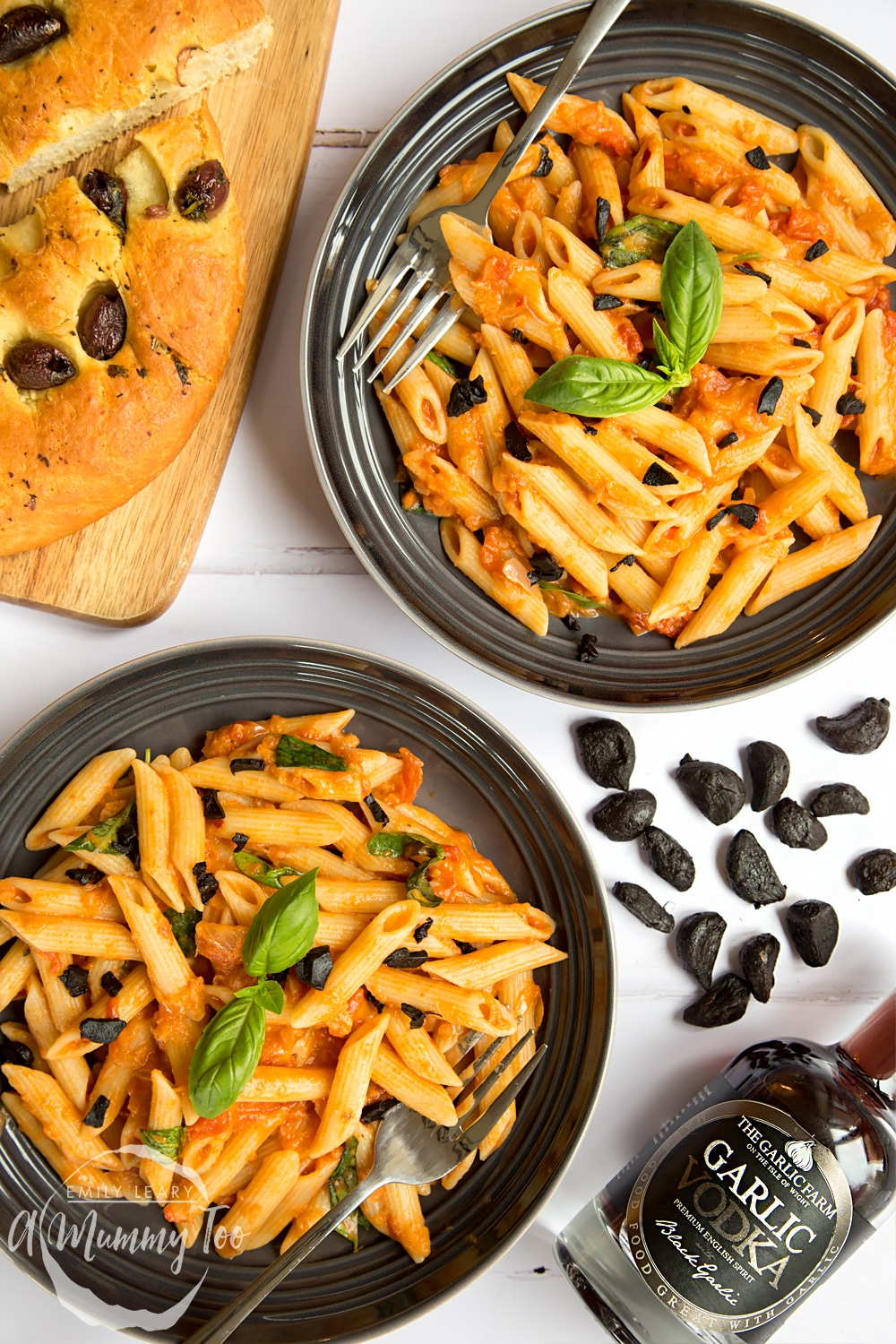 Penne alla black garlic vodka topped with black garlic, served with bread