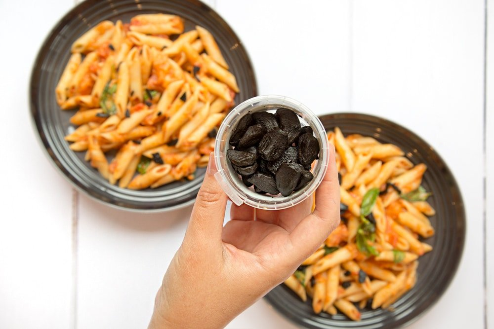 Penne alla black garlic vodka topped with slivers of black garlic