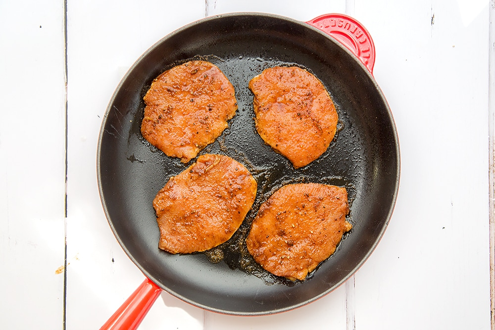 The marinated pork medallions are cooked in frying pan