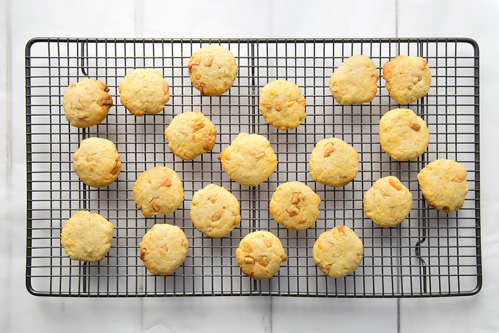Sweetcorn and white chocolate cookies cooling on a wire rack