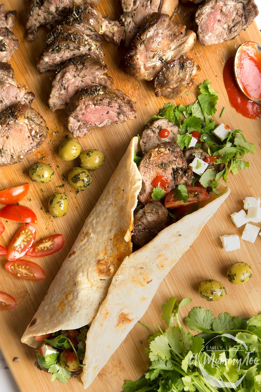 A herb crusted Welsh Lamb in a quick coriander flatbread wrap, shown alongside cooked lamb and salad