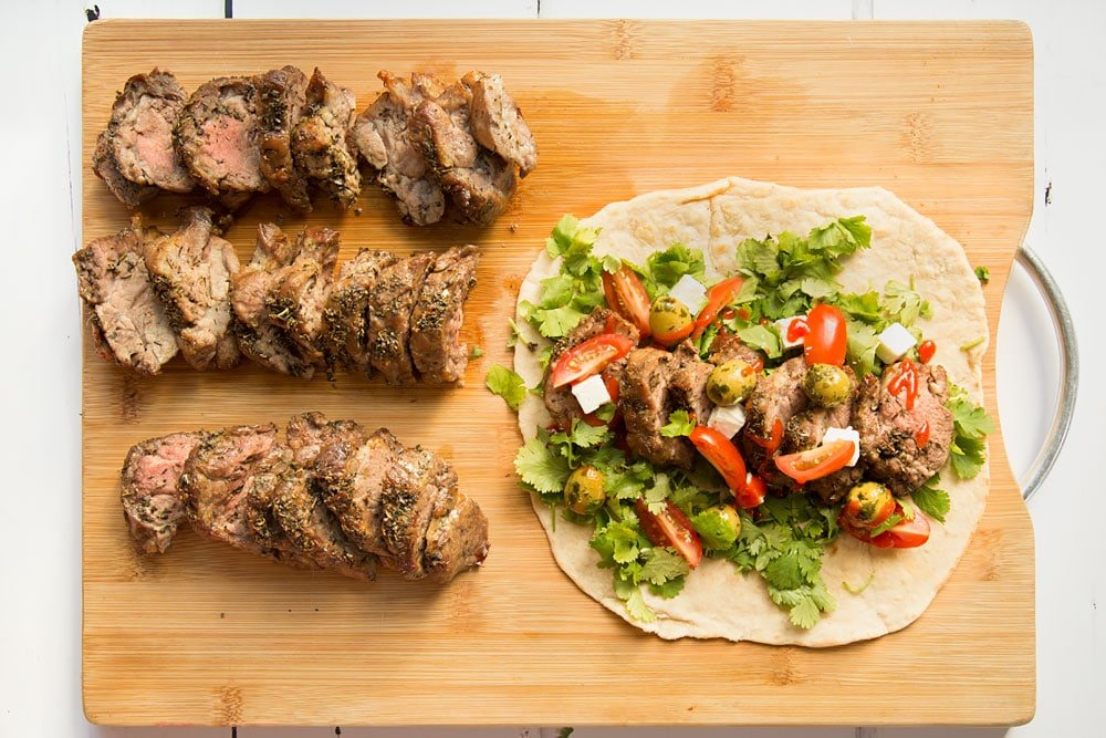 Assembling the herb crusted Welsh Lamb in a quick coriander flatbread wrap