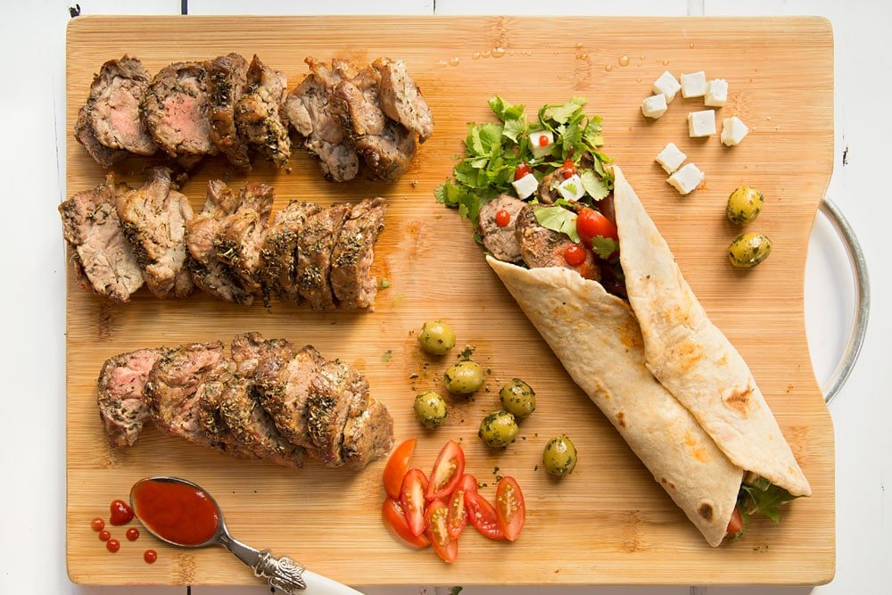 Finally, the flatbread is folded to finish your herb crusted Welsh Lamb in a quick coriander flatbread wrap