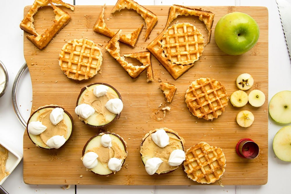 Assembling the waffle apple burgers