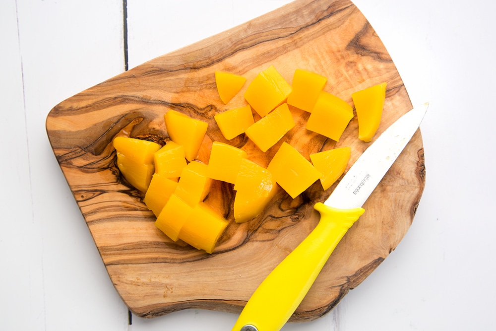 Preparing the mango for the breakfast bowls