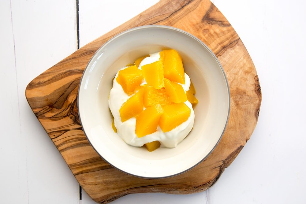 Add the remaining mango to create another layer in your breakfast bowl