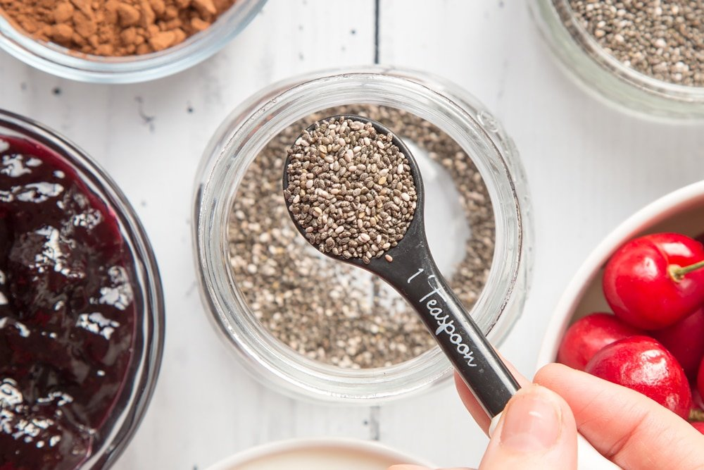 Chia seeds, shown on a measuring spoon