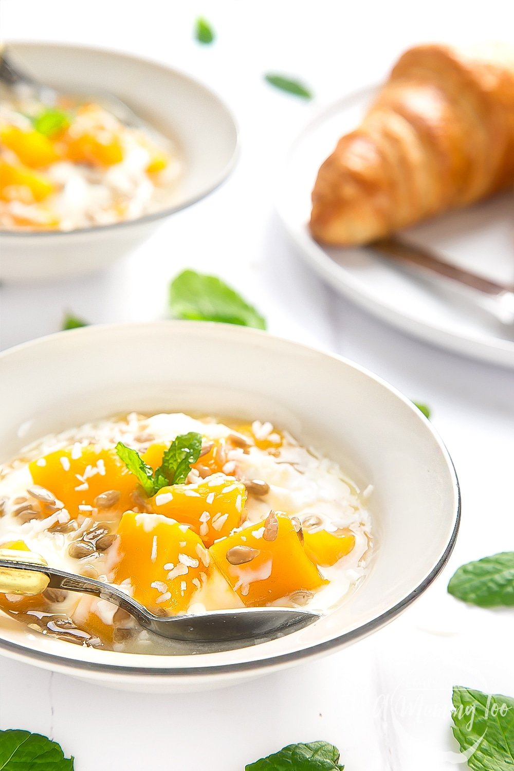Delicious yogurt and mango breakfast bowls, served on a breakfast table